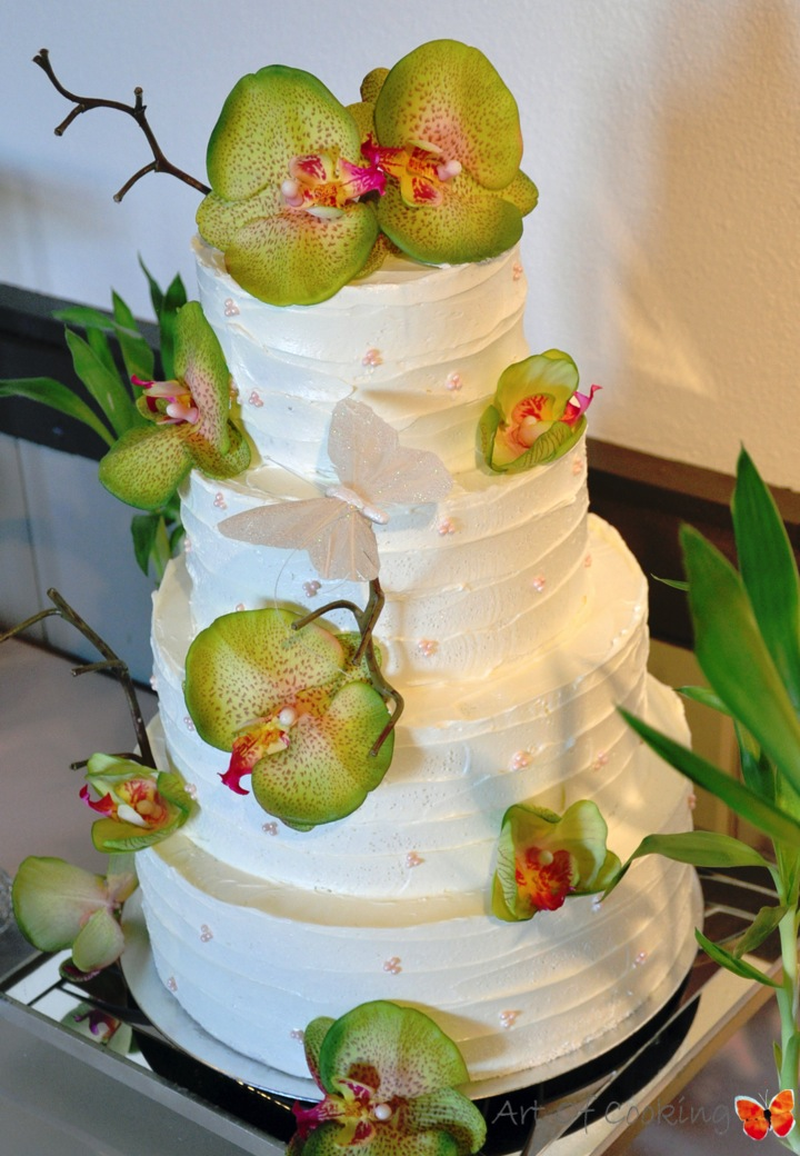 Tropical White Wedding Cake and green orchid flowers | Full Service ...