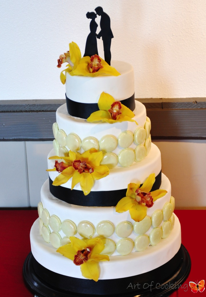 Black and White Wedding Cake with French macarons and yellow orchid ...