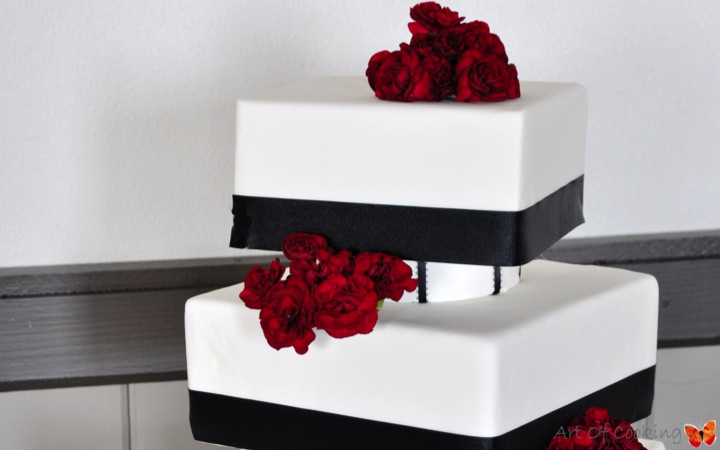Modern Square White and Black Wedding Cake with fresh red flowers   Full Service Catering and ...