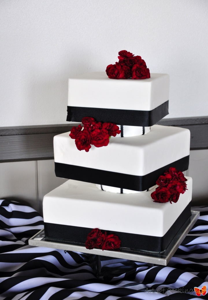Modern Square White And Black Wedding Cake With Fresh Red Flowers